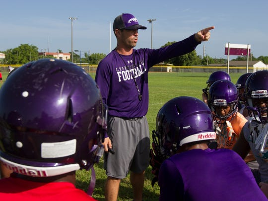 Cypress Lake High School's first year head football coach Richie Rode, speaks with seniors during its first varsity football practice of the upcoming school-year Monday morning (8/1/16).