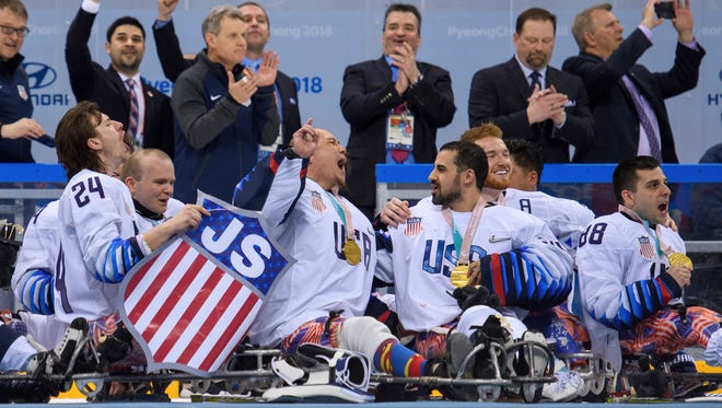 Josh Misiewicz (left) and other U.S. players celebrate with their gold medals after beating Canada in the Ice Hockey Gold Medal Game at the Gangneung Hockey Centre in Gangneung, South Korea, at the 2018 Winter Paralympics Sunday, March 18, 2018.