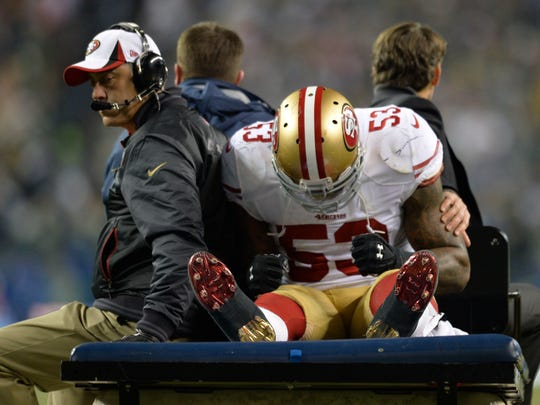 San Francisco 49ers inside linebacker NaVorro Bowman is carted off the field during the second half of the 2013 NFC Championship game.