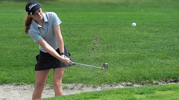 Roosevelt's McKayla Poppens chips to the green out of a sand trap during the Girls City Golf Meet at Elmwood Golf Course on Mon., May 4, 2015.