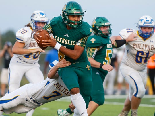 Springfield Catholic quarterback Tyson Riley shakes off Boliver defender Jonathan Vance during their game at Springfield Catholic High School on Friday, Sept. 15, 2017.