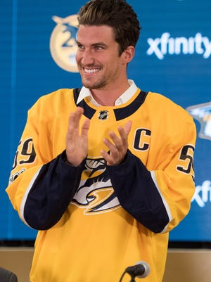 Roman Josi claps after being officially named the new captain of the Nashville Predators during a press conference Tuesday, Sept. 19, 2017, at Bridgestone Arena.