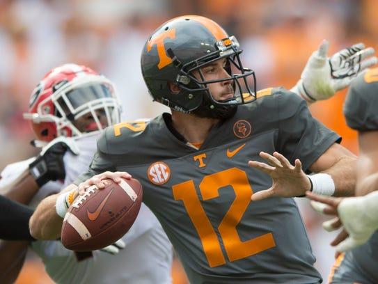 Tennessee quarterback Quinten Dormady (12) lines up
