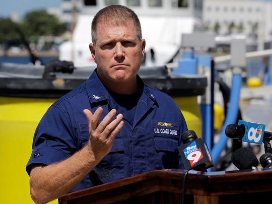 U.S. Coast Guard Capt., Gregory Case gestures during
