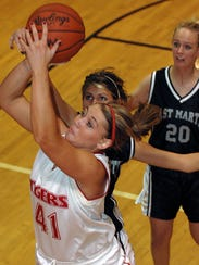 St. Philip's Allyson Doyle goes to the basket past
