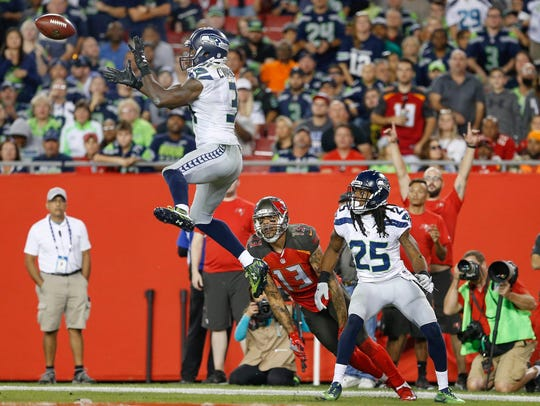 Seahawks strong safety Kam Chancellor ntercepts a pass
