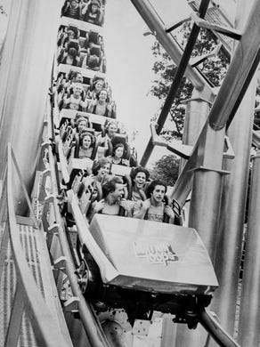 1978: Lightning Loop riders scream as the ride takes a downward plunge.