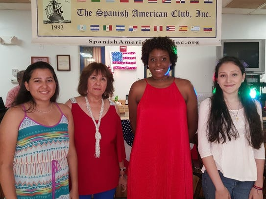 Scholarship director Nancy Rozon, second  from left,