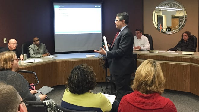 Consultant Will Calves talks about proposed route changes with St. Cloud Metro Bus officials and members of the board of commissioners on Friday, April 1.