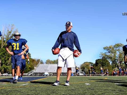 FILE – Marian football coach Mark Henninger has built a well-oiled machine in NAIA.