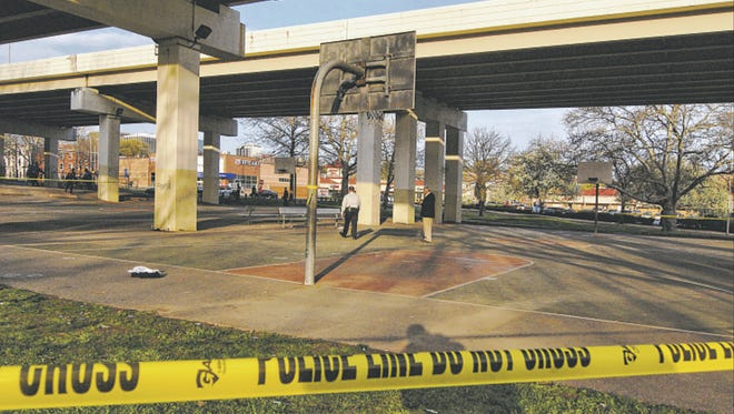 Police tape cordens off the basketball court at Second and Jackson streets under I-95 in Wilmington in mid-April, after 23-year-old Jamar Brown was fatally shot during a game there. Although the incident happened in broad daylight, his killer has not been identified.