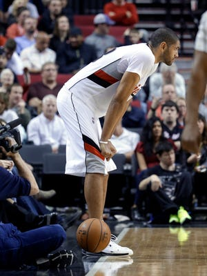 Portland Trail Blazers forward Nicolas Batum, from France, stands on the sideline after turning the ball over to the Utah Jazz after failing to inbound the ball in time, late in the second half of an NBA basketball game in Portland, Ore., Saturday, April 11, 2015.  Utah won 111-105. (AP Photo/Don Ryan)