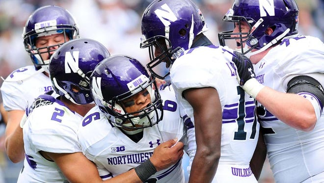 Northwestern Wildcats wide receiver Tony Jones (6) is congratulated by teammates after scoring a touchdown in the second quarter against the Penn State Nittany Lions at Beaver Stadium. Mandatory Credit: Evan Habeeb-USA TODAY Sports