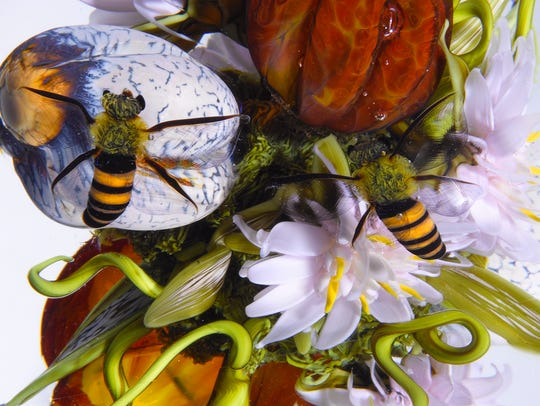 'Flowers, Fruits and Nuts with Honeybees Orb' is seen