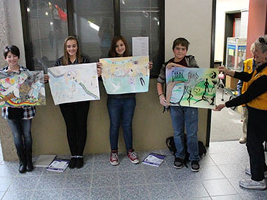 Cedar Middle School cash winners of the Lion's Club Peace Poster contest: left to right Angel Hillier, Shauna Zuefelt, Dallas Roberts, and Braxton Colburn. Not pictured: Kayla Colburn.