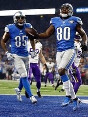 Lions receiver Anquan Boldin celebrates with Eric Ebron (85) after catching a touchdown against the Minnesota Vikings in the first quarter at Ford Field on Nov. 24, 2016 in Detroit.