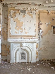 The fireplace in a bedroom at 359 W. Church St. in
