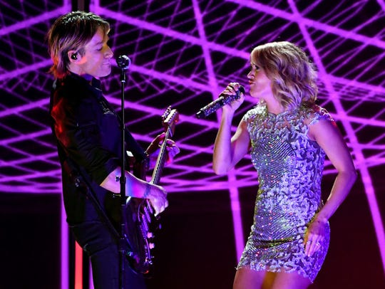 Recording artists Keith Urban and Carrie Underwood