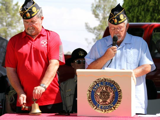 Ed Miller, left, sounded a bell as Chaplain Dan Kline took roll call for our fallen heroes.