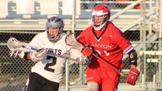 Shadowing each other during Thursday's Division 1 regional boys lacrosse contest are Troy's Andrew Hadad (left) and Canton's Jay Krebs.