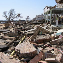 Hurricane Katrina destroyed every business on the waterside of Beach Road in downtown Bay St. Louis, Miss., even devouring the roadway itself.