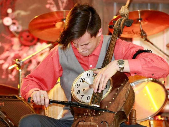 """Max McIntosh plays the cello during the """"Steamers &"""