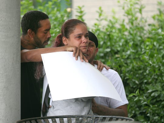 Sophia Benitez is comforted by family and friends after