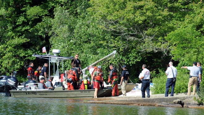 State and local officials launch from Fisherman's Landing on Mashpee-Wakeby Pond on Tuesday afternoon after a reported boating incident. A regional dive team later recovered the body of man involved in the incident.