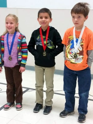 Top three placers in the Spelling Bee include, from left, are Ruth Perkins, first place, first grade; Andres Placencia, second place, second grade; and Samuel Herrera, third place, first grade.