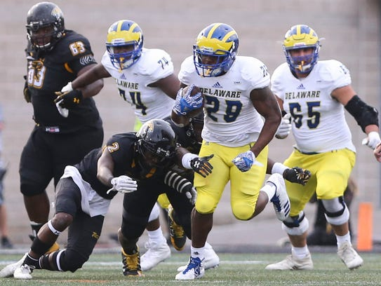 Delaware's Kani Kane takes the ball upfield as he is