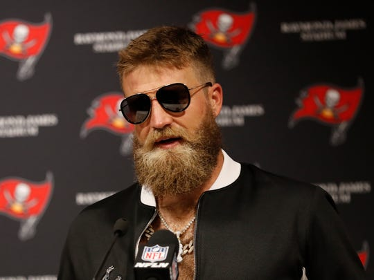 Tampa Bay Buccaneers quarterback Ryan Fitzpatrick takes questions after a 27-21 victory over the Philadelphia Eagles on Sept. 16, 2018.