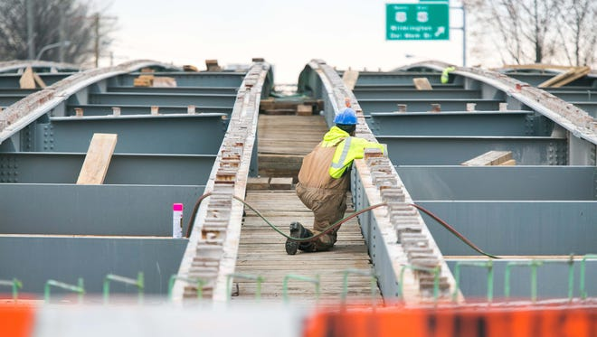 Work continues Tuesday on the Del. 141 bridge deck over U.S. 13, near New Castle. Work on the 62-year-old bridge was necessary after repeated deck patching efforts as a result of deck punch-throughs over the last several years, each of which resulted in road closures while the holes were patched.