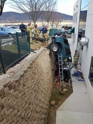 A 70-year-old man drove his SUV over an embankment outside the Golden Visions Adult Day Services building, according to police. (Photo: Cindy Miller)