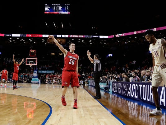 Louisville's Ryan McMahon (30) celebrates after making a 30point basket as Florida State's Braian Angola (11) reacts during the first half of an NCAA college basketball game in the second round of the Atlantic Coast Conference tournament Wednesday, March 7, 2018, in New York. Louisville won 82-74. (AP Photo/Frank Franklin II)