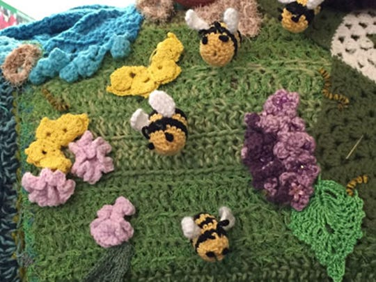 "One new feature of the Minnesota State Fair is a ""yarnbomb."""