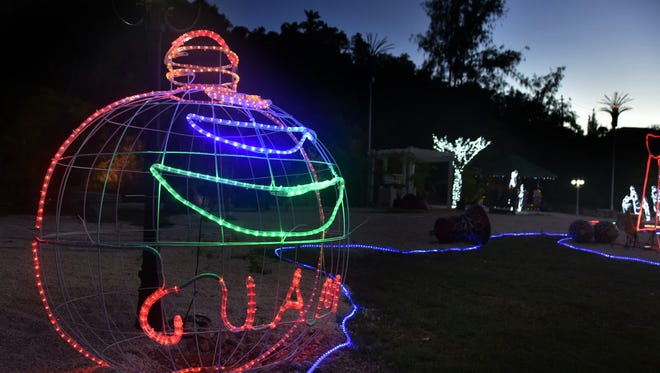 Lights were turned on at the Guam Visitors Bureau's Christmas Village in Tumon, near Ypao Beach, on Nov. 27. Masako Watanabe/Pacific Daily News/mwatanabe@guampdn.com