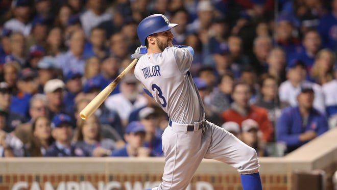 Chris Taylor hits a solo home run against the Cubs in the third inning.
