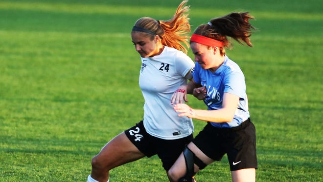 Kristina Lynch (left) fights off a defender in a game last season.