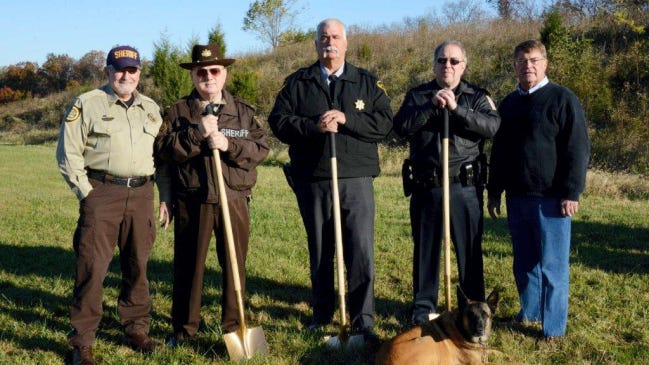 The Adams County Law Enforcement Training Range Committee, including Sheriff Jim Muller, Deputy Sheriff Len Supenski, Chief John Perry, Office Joe Henry and Commissioner Randy Phiel, pose during Friday's groundbreaking ceremony for the new shooting range in Straban Township.
