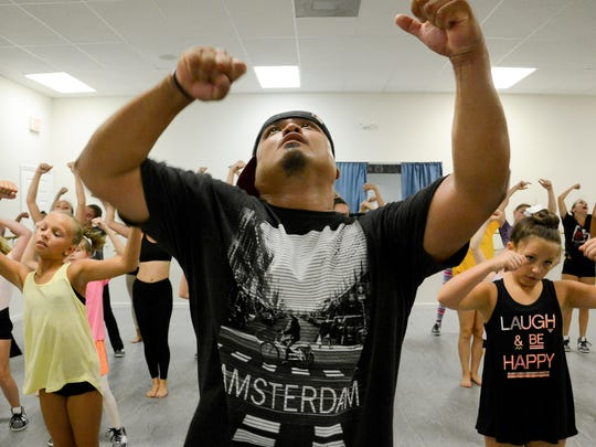 Nestor Funelas teaches hip hop dancing to a group of young ladies at Viera Dance Conservatory in Melbourne.
