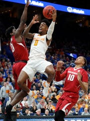 Tennessee's Jordan Bone, center, heads to the basket
