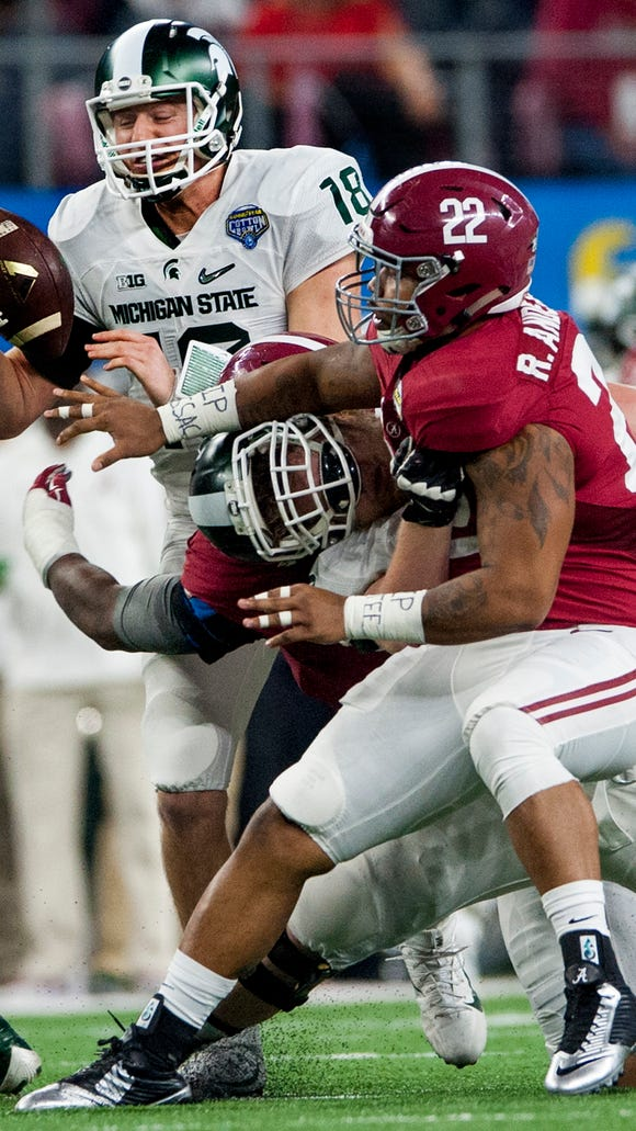 Michigan State quarterback Connor Cook (18)  is sacked by Alabama defensive lineman Jonathan Allen (93) and linebacker Ryan Anderson (22) during first half action in the Cotton Bowl on Thursday December 31, 2015 at AT&T Stadium in Arlington, Tx.