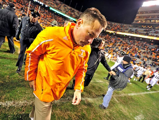 Tennessee Coach Butch Jones walks off the field after