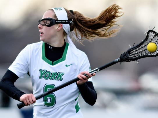 Meghan Fox, seen here in a file photo, is the leading scorer on a York College women's lacrosse team that boasts a 13-4 record. The Spartans begin NCAA Division III playoff action at home on Sunday against either Cabrini or Washington & Lee. YORK DISPATCH FILE PHOTO