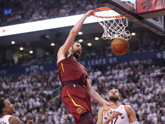 Cleveland Cavaliers forward Kevin Love (0) dunks the