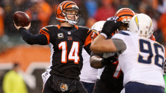 Bengals quarterback Andy Dalton (14) throws the ball against the Chargers in their AFC wild-card playoff game in January.