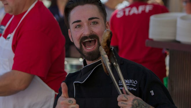 La Strada assistant chef Stevie Borghesi cooks sausages at the 35th annual Eldorado Great Italian Festival  in downtown Reno, Oct. 8-9, 2016. The 2017 festival runs Oct. 7-8 in downtown Reno.