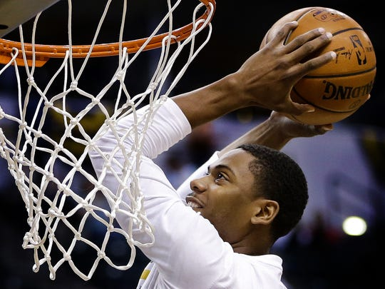 Indiana Pacers guard Glenn Robinson III (40) gets a warmup dunk in before facing off against the Toronto Raptors at Bankers Life Fieldhouse on March 17, 2016.