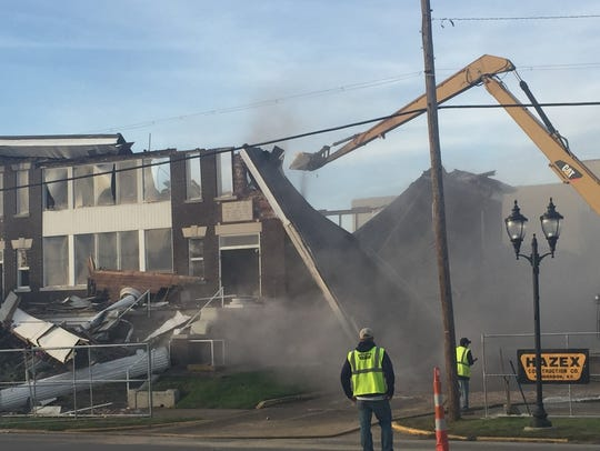 After the roof collapsed, Hazex workers continue to
