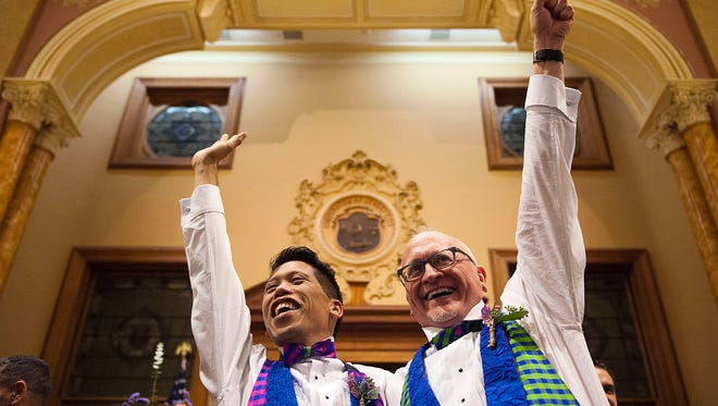 David Gibson, right, and Richard Kiamco of Jersey City make history as they become the first official same-sex couple to be married in Jersey City on Oct. 21, 2013.
